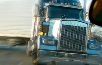 front of a truck seen from perspective of a car driver