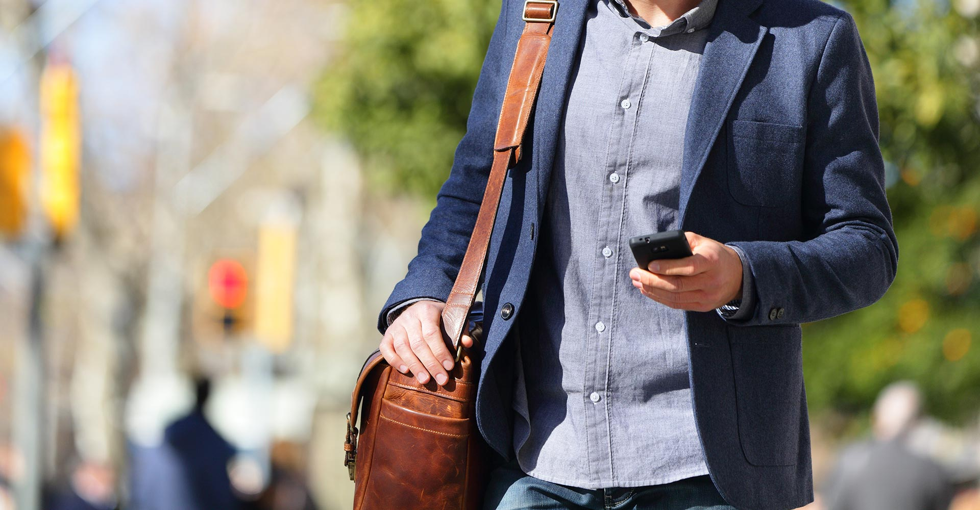 A man texting while crossing the street