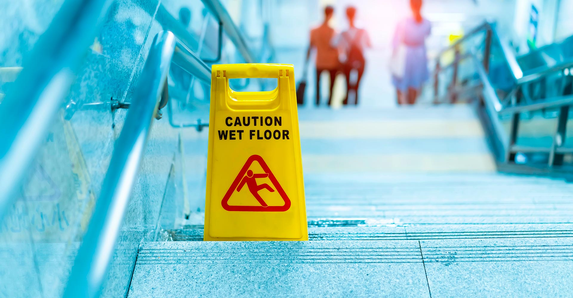 caution wet floor warning on steps in a public place